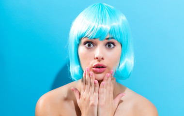 Wall Mural - Beautiful woman in a bright blue wig