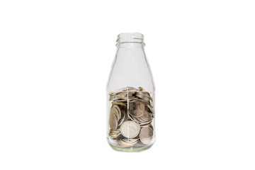 Saving money concept of collecting coins in a glass bottle isolated with white background