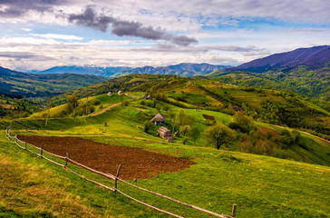 wooden fence on the hillside in Carpathian rural area