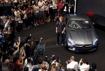 Mercedes Formula One driver Nico Rosberg of Germany poses with a Mercedes car during a meet-the-fans session ahead of the Singapore F1 Grand Prix night race in Singapore