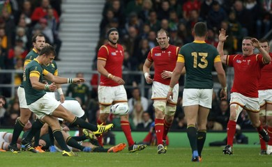 Pollard of South Africa kicks a drop goal against Wales during their Rugby World Cup quarter-final at Twickenham in London