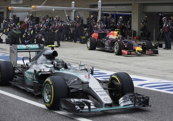 Mercedes driver Rosberg, of Germany, exits the pits ahead of Red Bull driver Kvyat, of Russia, during the Formula One U.S. Grand Prix auto race at the Circuit of the Americas in Austin
