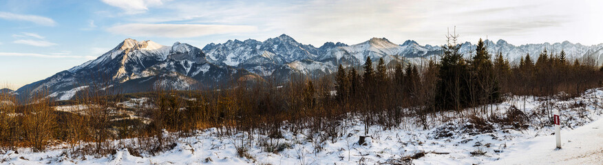 Panorama of mountain peaks covered with fresh snow.