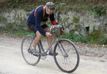 """Berruti, 73, rides a vintage bicycle on gravel roads during the Strade Bianche section of the """"Eroica"""" cycling race for old bikes in Gaiole in Chianti"""