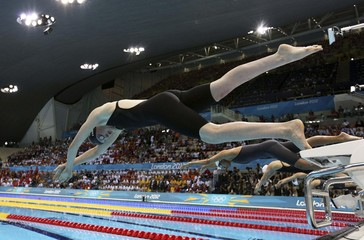 Missy Franklin of the U.S. dives into the pool at the start of the women's 100m freestyle swimming final during the London 2012 Olympic Games
