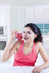 Indian woman with bunch of ripe grapes