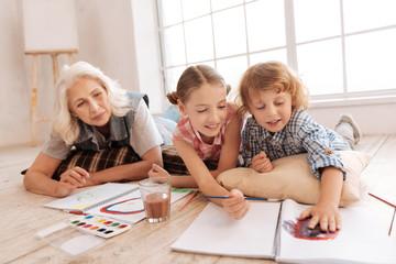 Positive creative children having an art lesson