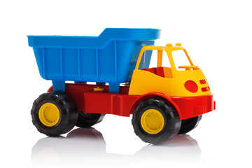 Baby beach toys. Plastic car or truck isolated on white background
