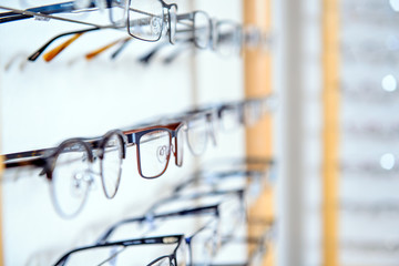 in optician shop- different  glasses for sale in wall rack Wall mural