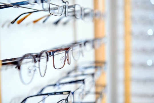 in optician shop- different  glasses for sale in wall rack