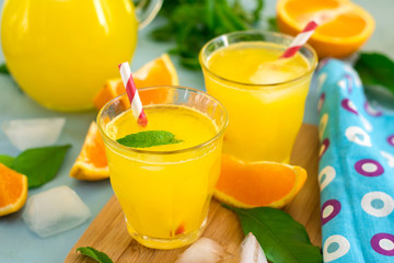 Sweet orange drink with ice and mint leaves