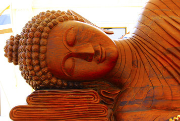 Buddha carved from wood. Hand made work of faith.