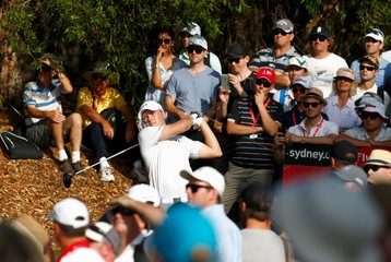 Members of the crowd watch as U.S. golfer Jordan Spieth tees off during the first round of the Australian Open golf tournament at the Australian Golf Club in Sydney, Australia