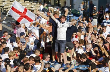 England fans stand on a car roof in Nice - EURO 2016