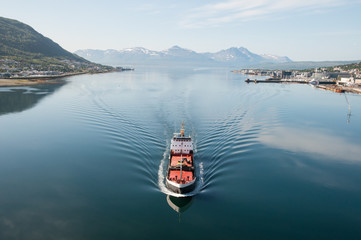 Ship in Tromsö, Norway, with panorama view to mountains in the background
