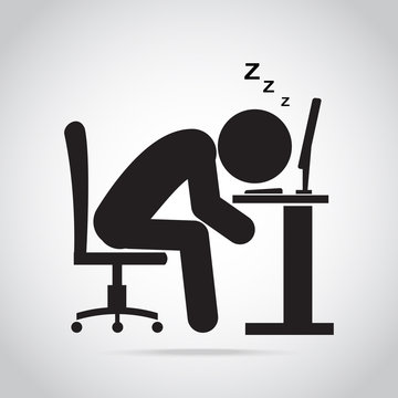 Man sleeping front of computer on work table