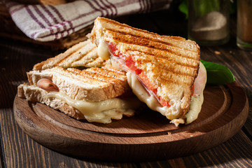 Photo sur Toile Snack Panini with ham, cheese and lettuce sandwich