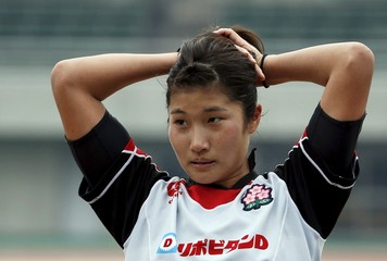 Japan's sevens women's rugby team vice captain Tomita ties her hair up after their training session for Olympic Games in Kumagaya