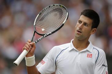 Men's Singles - Serbia's Novak Djokovic looks dejected during the final