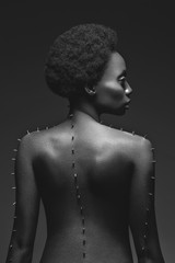 Beautiful black girl with metal pins