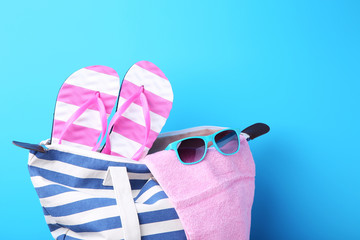 Summer bag with sunglasses, towel and flip flops