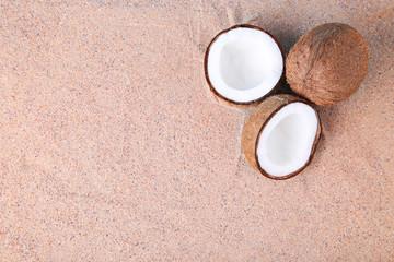 Half of coconut on the beach sand