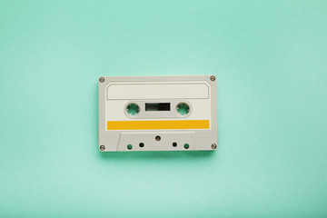White cassette tape on mint background