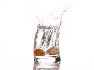 Tomato falls in a glass of water - Splash