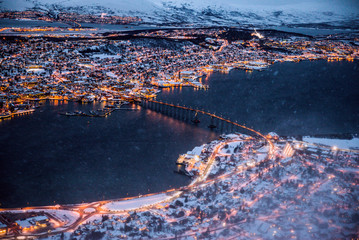 Large panoramic view over Tromso, Norway, at twilight with a cloudy sky