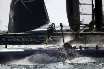 A crew member scampers to the windward hull as AC45F racing sailboat Artemis Racing rounds leeward mark on their way to winning the America's Cup World Series sailing competition in Hamilton
