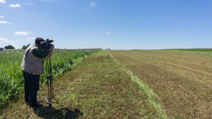The cameraman shoots the forage preparation process on the camera. Agriculture.