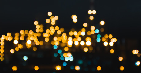 Beautiful glowing city in the bokeh in the rain gorgeous background texture