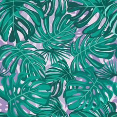 Seamless pattern with exotic tropical leaves. Decorative vector background.