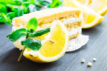 Lemon cake with mint leaves and lemon slices