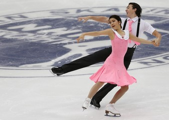 Muramoto and Reed of Japan perform during the ice dance free dance program at the ISU Grand Prix of Figure Skating in Nagano