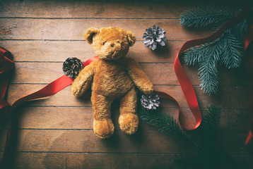 Little Teddy Bear with Christmas pine cones