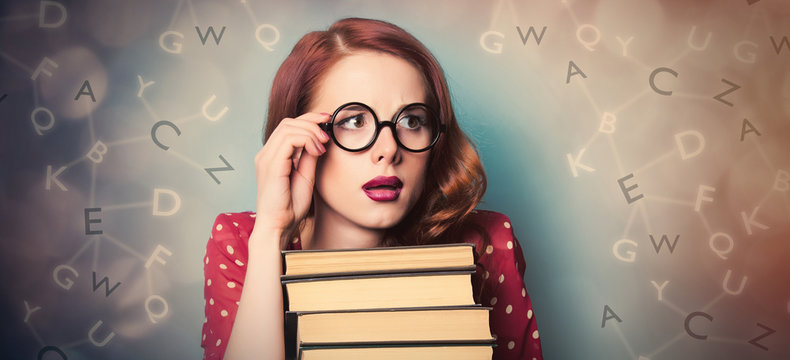 beautiful young woman with pile of books on the wonderful blue background