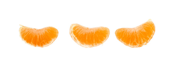 Three wedges segments of mandarin orange on white