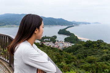Woman travel in amanohashidate at Japan