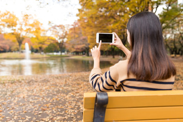 Woman taking photo in the park