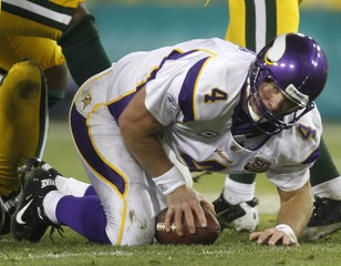 Minnesota Vikings quarterback Brett Favre is sacked by the Packers defense in Green Bay