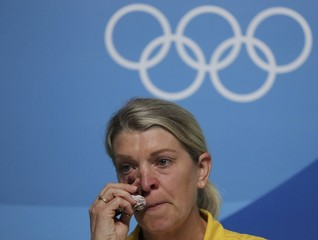 Kitty Chiller wipes her eyes during a press conference in Rio de Janeiro