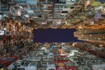 Low angle view of crowded residential towers in an old community in Quarry Bay, Hong Kong. Scenery of overcrowded narrow apartments, a phenomenon of high housing density & housing blues in Hongkong.