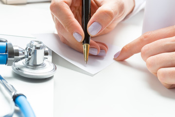 the doctor writes a prescription pil