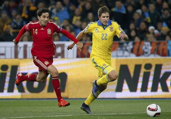 Spain's Etxeita chases Ukraine's Kravets during the Euro 2016 group C qualifying soccer match at the Olympic stadium in Kiev