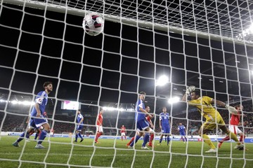 Switzerland's Lang scores a goal against San Marino's goalkeeper Simoncini during their soccer match against San Marino's in St. Gallen