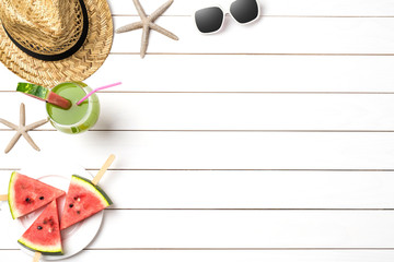 Summer background with watermelon slices, straw hat and sunglasses