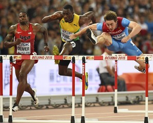 David Oliver of the U.S. (L), Hansle Parchment of Jamaica (C) and Sergey Shubenkov of Russia compete in the men's 110 metres hurdles final during the 15th IAAF World Championships at the National Stadium in Beijing