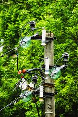 Insulators and electric wire on concrete pole