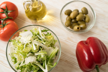 Salad ingridients. Tomato, lettuce, paprika and olive oil.